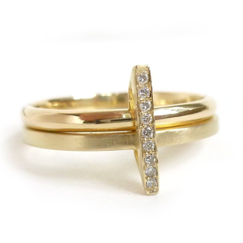 A unique, contemporary diamond ring. Multi band ring or interlocking ring, sometimes called double band ring too.
