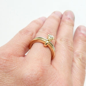 Alternative eternity ring or commitment ring by contemporary design and maker Sue Lane. Modern alternative engagement wedding ring - gold and diamond two band ring. Multi band ring or interlocking ring, sometimes called double band ring too.