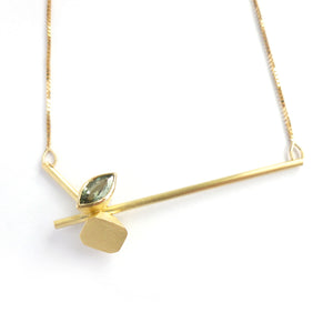 Contemporary gold and green sapphire necklace by designer / maker Sue Lan e