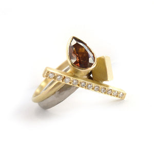 Bespoke and unique 18ct white and yellow gold, garnet and diamond ring