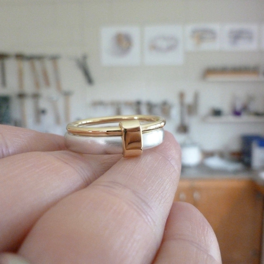 Unusual, unique, bespoke and modern three band stacking ring in silver and gold. Handmade by Sue Lane Jewellery in Herefordshire, UK. Unique wedding ring.