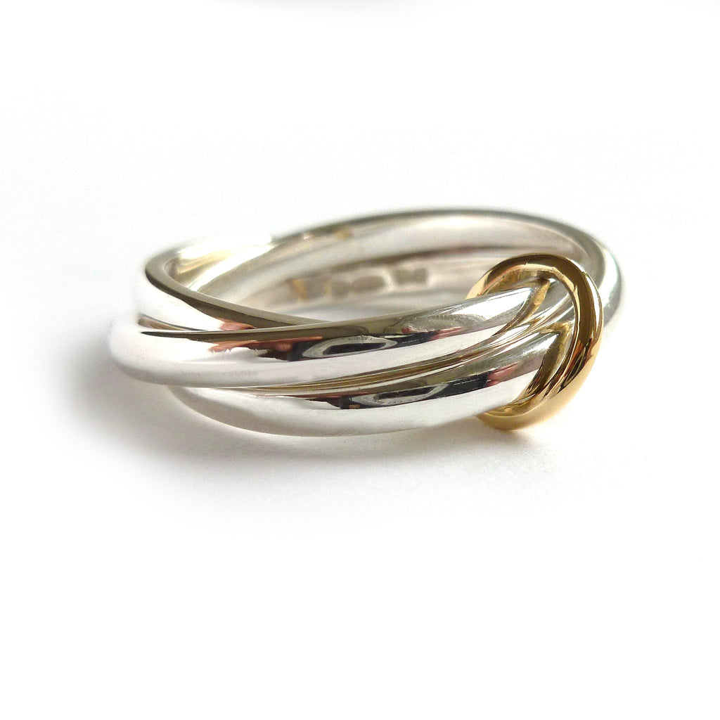 silver and gold modern ring