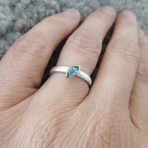 modern silver and aquamarine stacking ring with brushed finish