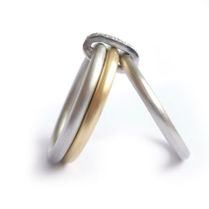 Handmade three band ring, joined together with a band of diamonds handmade by Sue Lane UK - gold platinum. Multi band ring or interlocking ring, sometimes called triple band rings too.