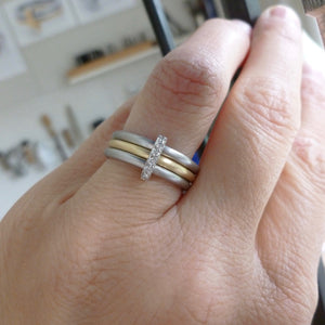 Handmade three band ring, joined together with a band of diamonds handmade by Sue Lane UK - platinum gold. Multi band ring or interlocking ring, sometimes called triple band rings too.