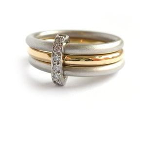 Contemporary two tone, platinum and yellow gold three band stacking ring with diamonds