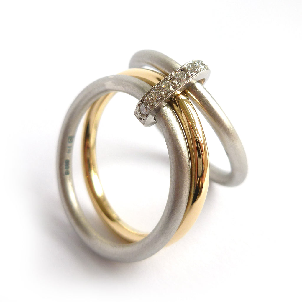 modern two tone, white and yellow gold three band stacking ring with diamonds