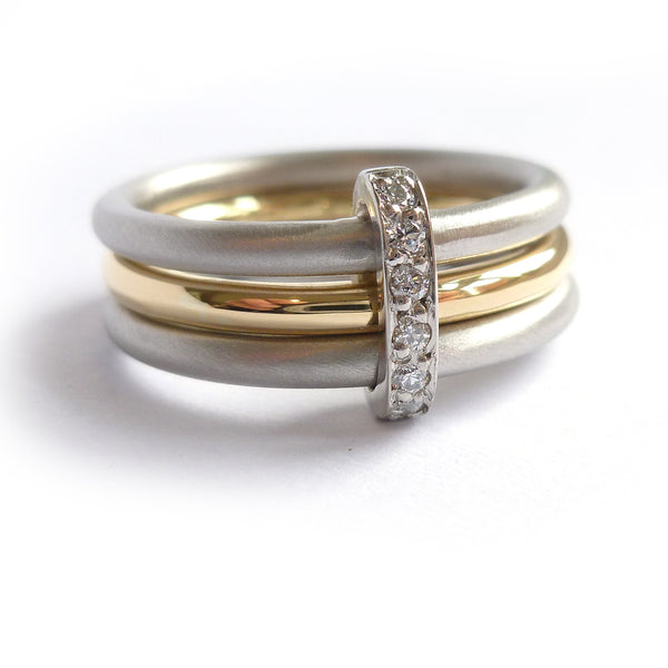 modern two tone, white and yellow three band ring with diamonds