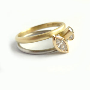 modern bespoke white and yellow gold and marquise diamond ring
