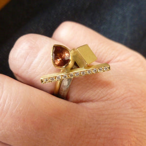 one of contemporary gold, diamond and colour change garnet ring