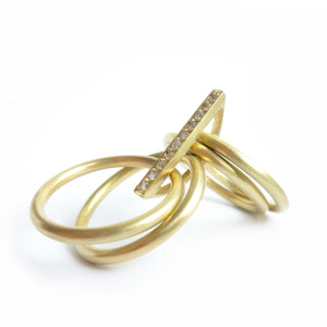 contemporary yellow gold and diamond 4 band stacking rings with a brushed finish