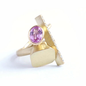modern and contemporary gold and pink sapphire ring with pave diamonds