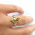 bespoke platinum and gold ring with natural green pear shape diamond with GIA certification