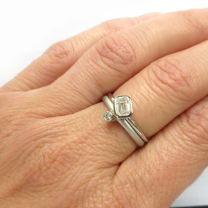 Bespoke platinum and emerald cut two band stacking diamond engagement  ring