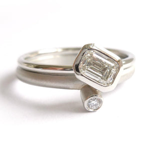 modern platinum and emerald cut diamond engagement and wedding ring