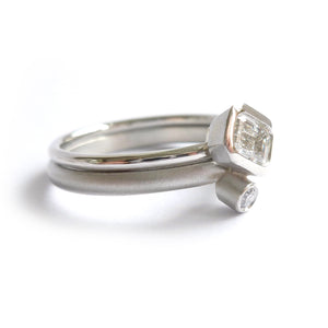 stacking modern platinum and emerald cut diamond engagement and wedding ring