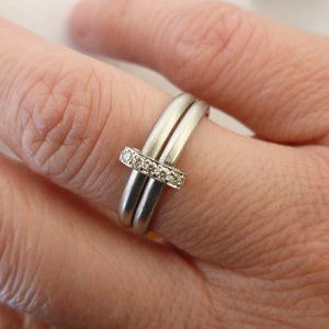 Contemporary two band platinum stacking ring with pave set diamonds. Multi band ring or interlocking ring, sometimes called double band ring too.