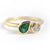 Pear shape emerald and diamond ring contemporary unique and modern.