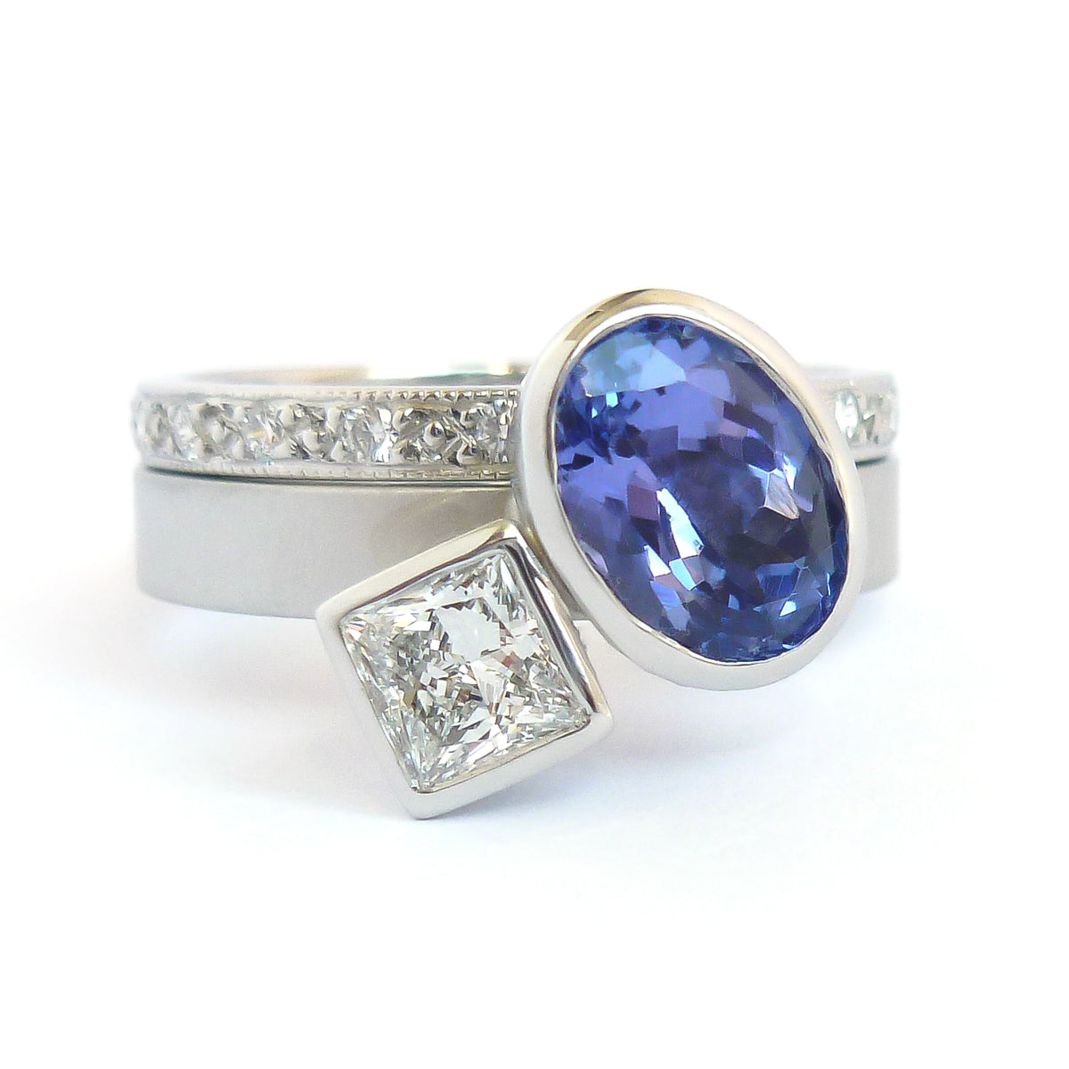 Platinum and tanzanite two band stacking ring set - contemporary, modern, bespoke and unique - interlocking.