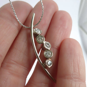 Platinum necklace, pendant, with diamonds, contemporary, bespoke, modern and unique.