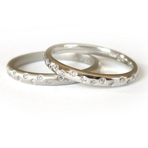 Platinum and diamond engagement, wedding or eternity ring