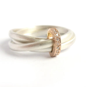 Unique modern silver and gold two tone Russian style wedding ring with diamonds