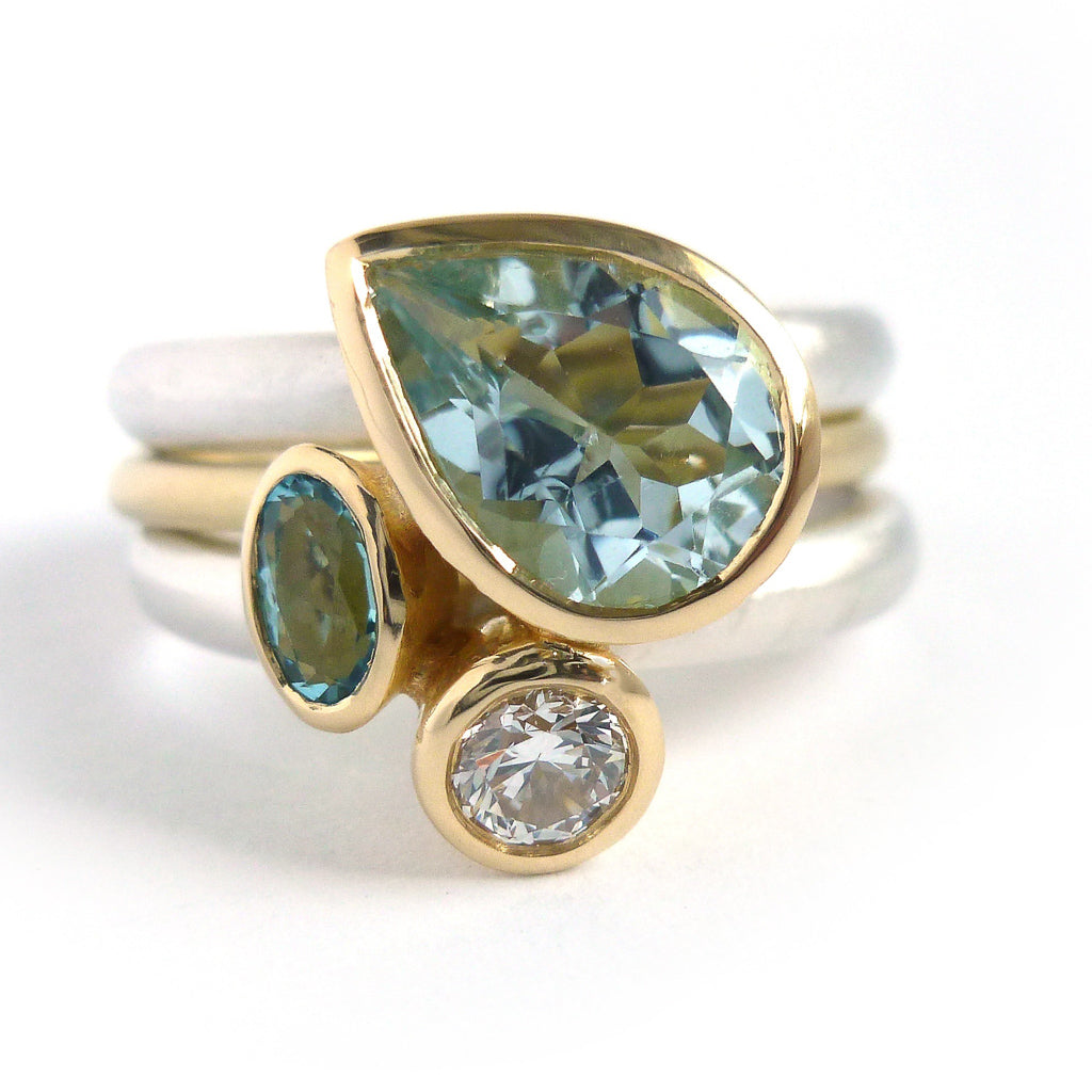 Unique and contempory 18ct gold and silver aquamarine and diamond ring
