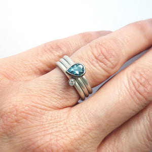 A unique, contemporary aquamarine and diamond gold and silver ring