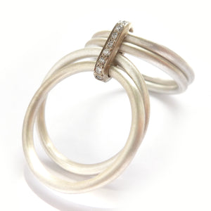 Contemporary unique bespoke handmade and modern silver and gold two tone pave set diamond ring handmade by Sue Lane
