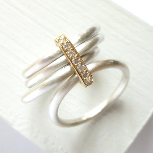 Unique contemporary wide band silver and gold ring with white diamonds
