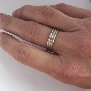 Contemporary modern wedding ring for men or women 18ct white gold.