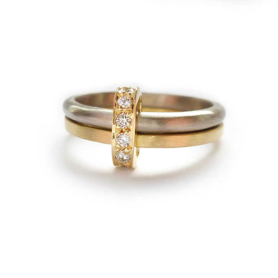 modern and bespoke two band two tone ring with pave set diamonds hand made in UK