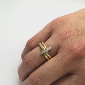 A unique contemporary unique two tone gold and diamond ring