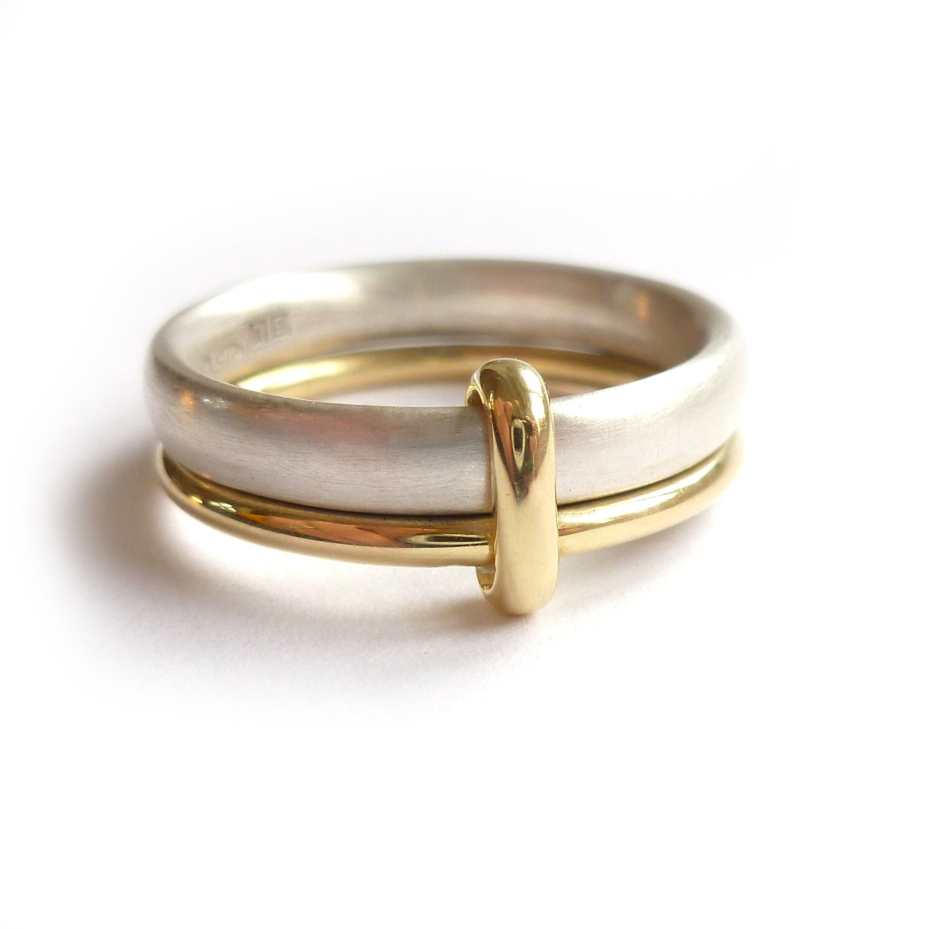 Simple and modern two band stacking ring in silver and gold