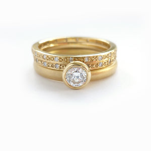 modern and bespoke gold and diamond stacking ringset handmade in the UK