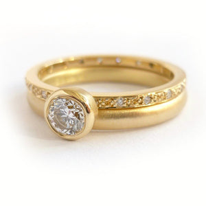Modern two band diamond ring alternative modern engagement ring Sue Lane. Modern alternative engagement wedding ring - gold and diamond two band ring. Multi band ring or interlocking ring, sometimes called double band ring too.