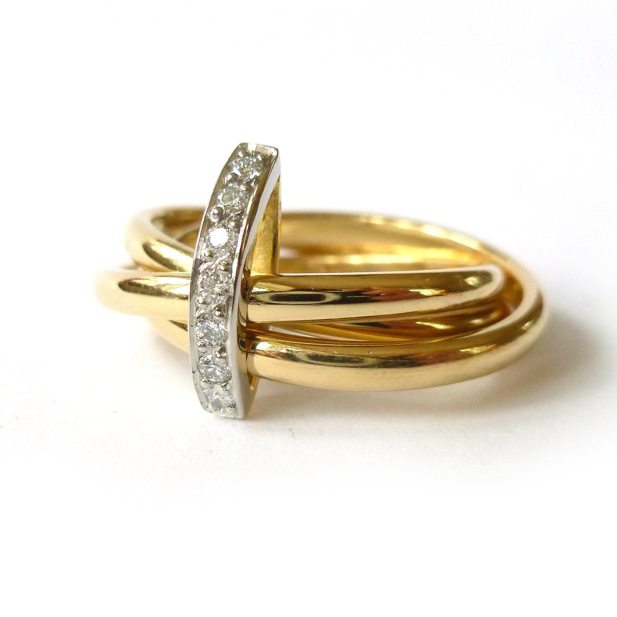 Modern russian ring style design in yellow gold and platinum with white diamonds pave set to join them