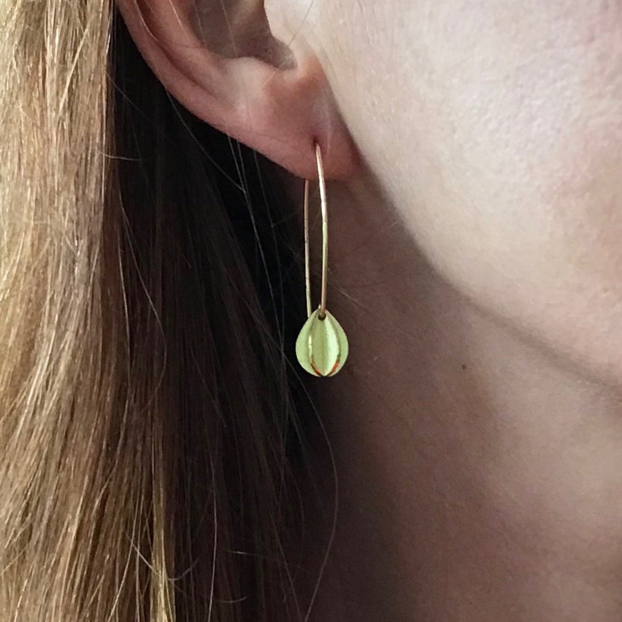 simple modern leaf hook earrings in yellow gold handmade with a brushed finish