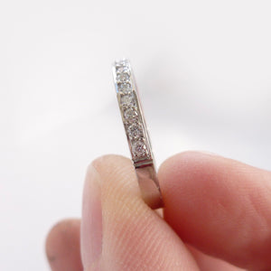 Modern platinum eternity or wedding ring with 17 pave set white diamonds