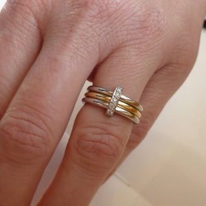polished yellow gold and platinum modern eternity ring handmade in UK. Multi band ring or interlocking ring, sometimes called triple band rings too.