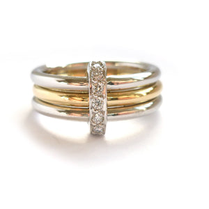 Modern two tone, platinum and yellow gold three band stacking ring with diamonds