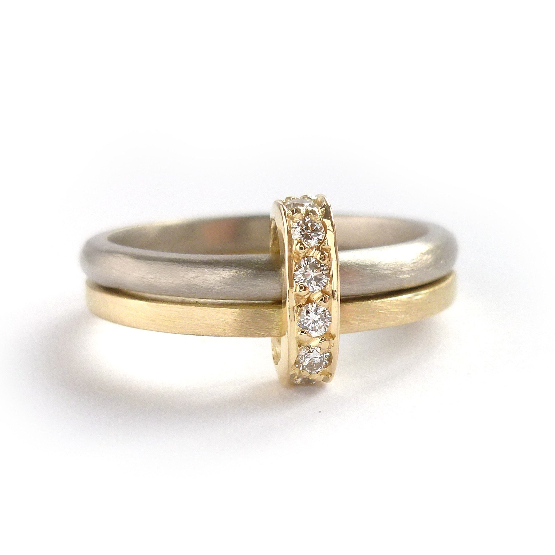 Modern and bespoke two band two tone ring with pave set diamonds. Modern, unique two band ring joined together with diamonds. An alternative eternity or wedding ring. Multi band ring or interlocking ring, sometimes called double band ring too.