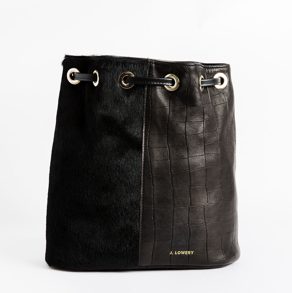 calf hair and black leather drawstring closure backpack