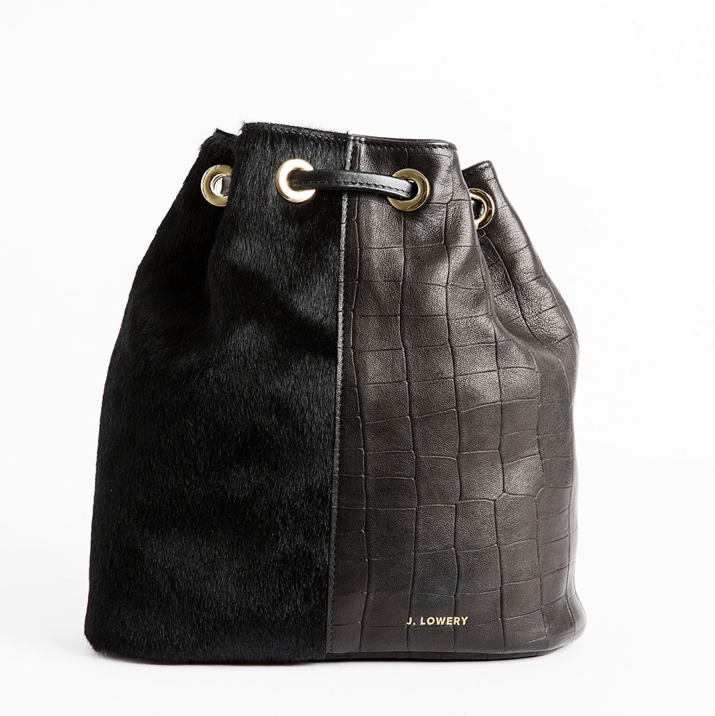 calf hair and black leather backpack