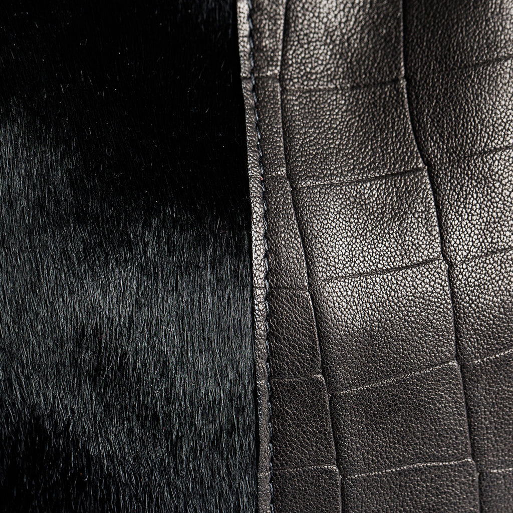 close-up calf hair and black leather