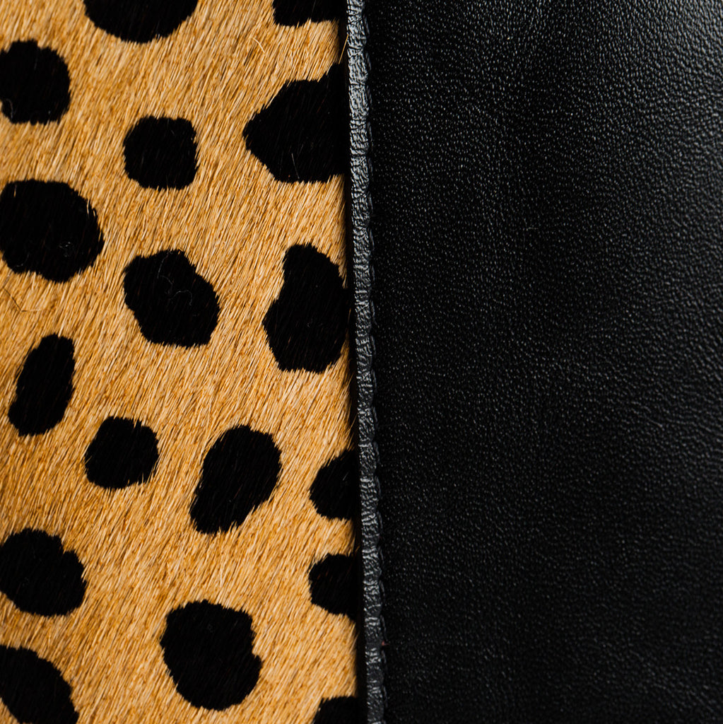 close-up cheetah calf hair and black leather