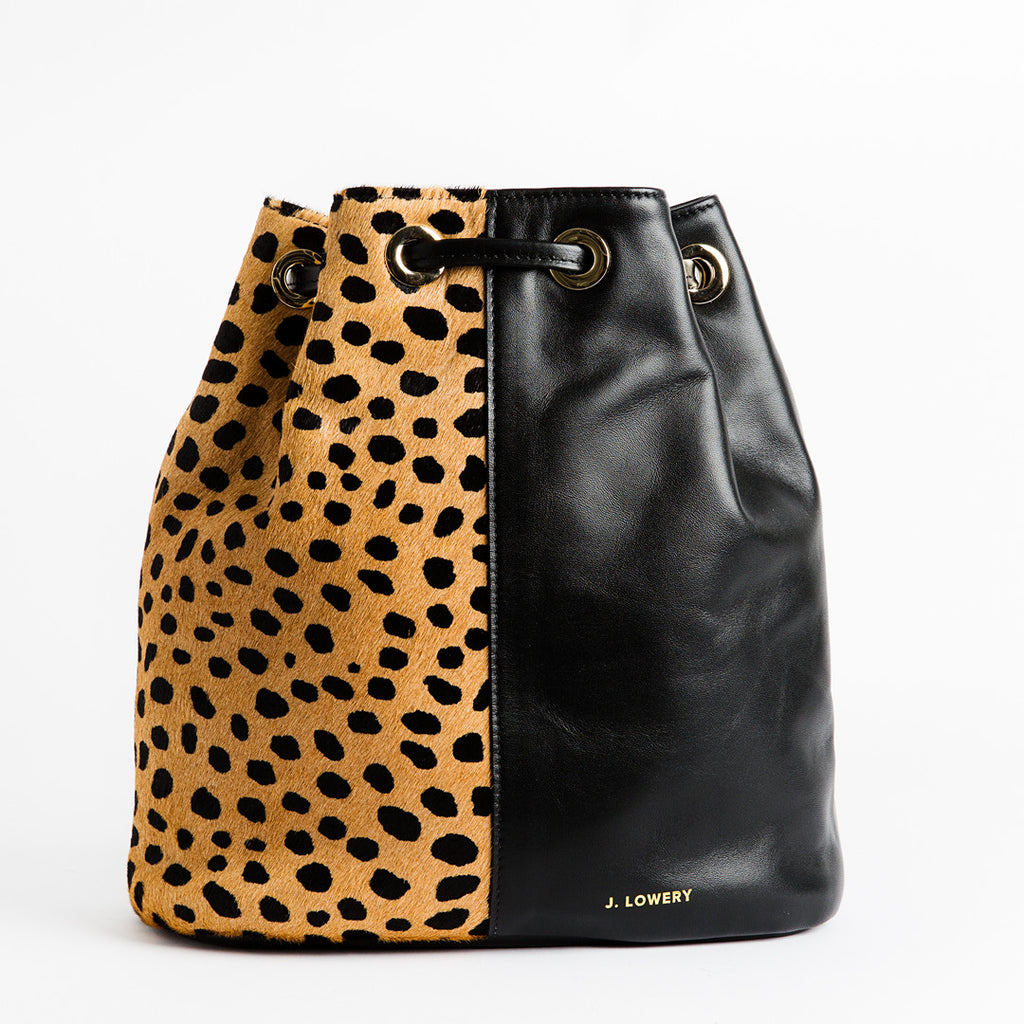 cheetah calf hair and black leather backpack