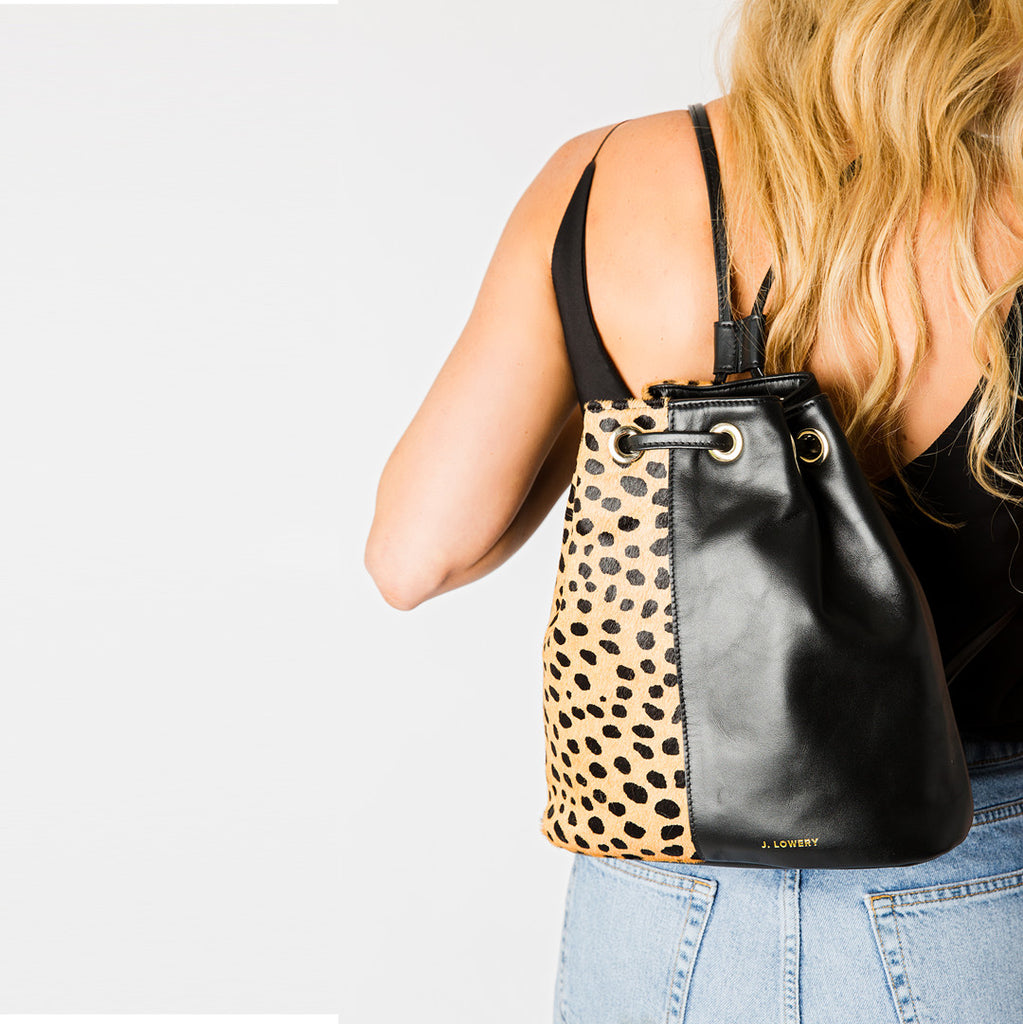 cheetah calf hair and black leather backpack on woman