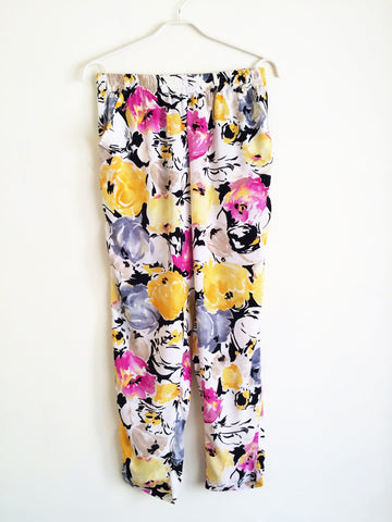 A pair of Pocket Pants - Yellow Black floral pattern from Tuni