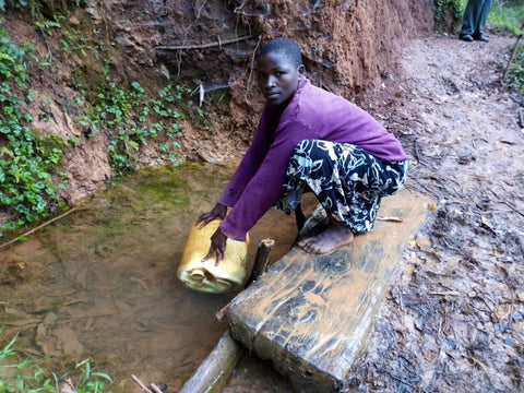 Woman Gathering Water from the Unprotected Spring